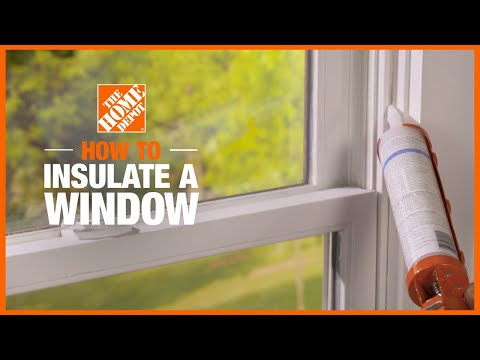 person insulating house windows in cold weather