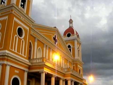 granada – la catedral + girl vendor + flag – plaza de la independencia