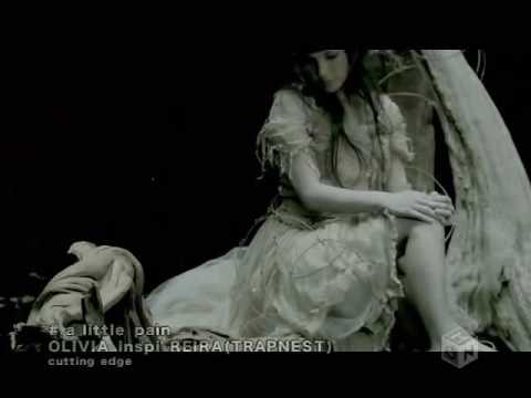 A Little Pain Espanol de Olivia Inspi Letra y Video