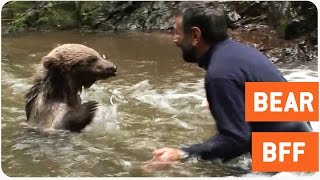 Man Plays with a Bear in Stream | Best Friends