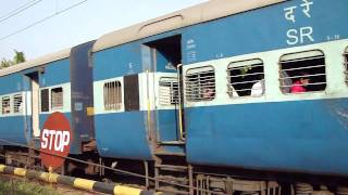 Train passing at a Railway Crossing nearby a Shiva Temple in Maraikulam (Kerala), 2009.