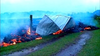 LAVA DESTROYS GRASS FIELD AND SHED... Above Pahoa's Apa'a St.