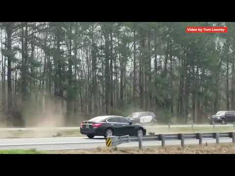 A car crashed into a median just yards from the president's motorcade as he was on his way to survey tornado damage in Lee County, Alabama, on March 8, 2019.  Video contributed by Tom Lowrey.