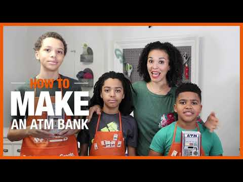 A family in orange aprons holding a DIY ATM bank.