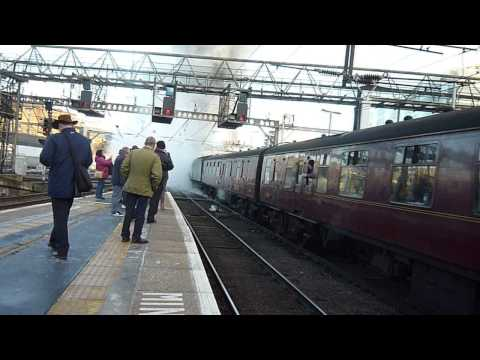 60009 Union of SA  glides out of King's Cross. Down Lindum Xmas Fayre. 08-Dec-2012.MOV