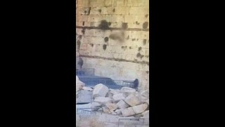 Block falls from Jerusalem's Western Wall, narrowly missing worshipper