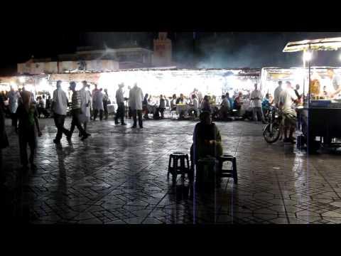 Conversation with food vendor in Djemmaa el-Fna, famous plaza in Marrakesh, Morocco