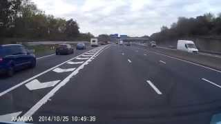 Car pulls off of M271 slip road across white lines onto M27 (from left to right)