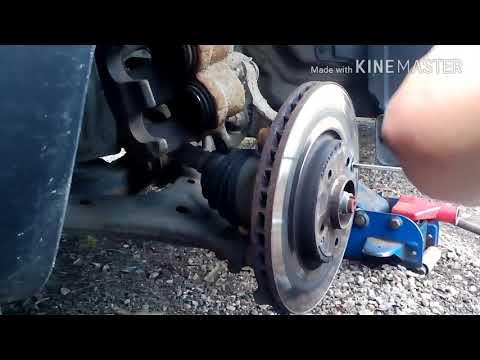 Замена тормозных передних дисков ssang ... action new 2012 года