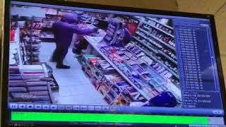 Watch the moment raider holds up Tipton shop at gun point