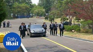 Kim Jong Un's body guards run alongside car carrying official - Daily Mail width=