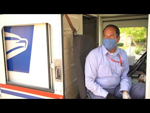 'Carriers are heroes too': mail deliveries continue despite pandemic   AFP photo