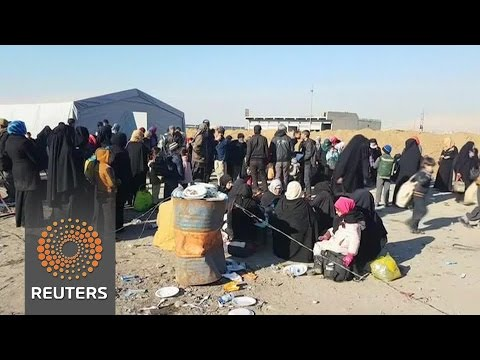 Civilians flee parts of Mosul as operation to retake the city continues