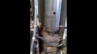Wood fire flue heat exchanger/ storage tank