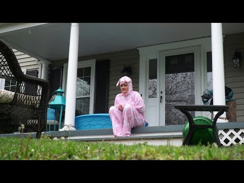 A Virginian plays dress up on her front porch to provide a little cheer | AFP photo