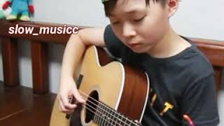 Despacito ( fingerstyle guitar arranged cover by 10 year _ old kid sean )