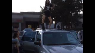 sexy teen girl dancing on car
