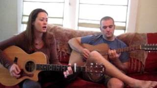 Melissa Mesko and Brian Mesko perfroming in the aeroplane over the sea - cover