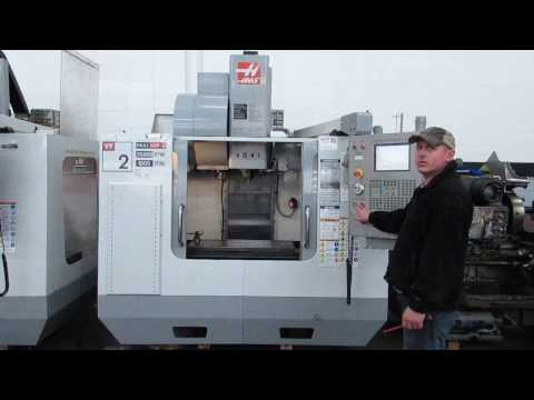Haas VF-2 30,000 RPM CNC Vertical Machining Center with 4th Axis Drive At Machinesused.com