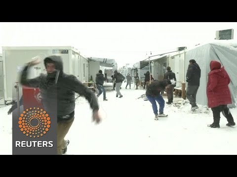 Refugees make best of sub-zero weather in Greek camps