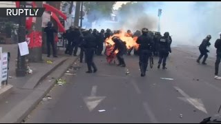 Clashes erupt between police & demonstrators during Paris protest