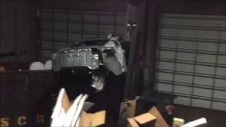 Watch this 350z get dropped in a dumpster from 15 ft!!!