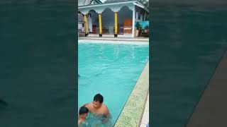 GHOST hands in pool