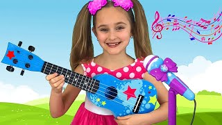 Sasha playing Guitar Music Toys and Sing Nursery Rhymes Kid songs on Talent Show
