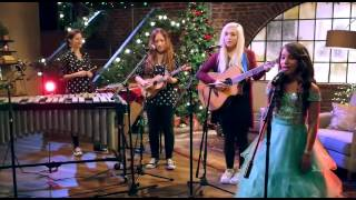 A Girl sings We wish you a Merry Christmas in a new style