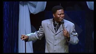 Bernie Mac breaks a microphone