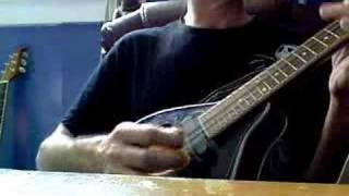 Psychic boy playing Celtic Music on the mandolin