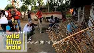 Members of  Photo Mentors workshop clicking pictures during village tour in Bandhavgarh