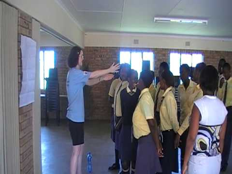 South Africa- Sally teaches the school children to sing