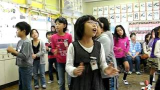 Japanese elementary school children singing a song