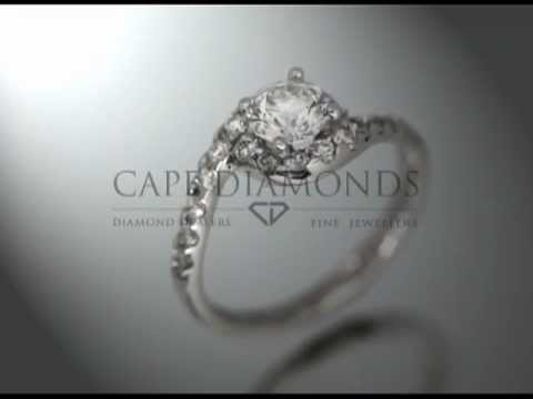 Complex stone ring,round diamond,little stones on band turning around stone,platinum,engagement ring