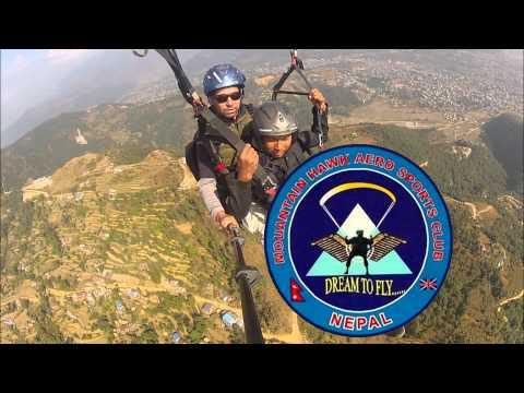 A calm paragliding tandem flight. Nepal, Pokhara.