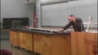 High speed ping-pong ball blows through soda cans