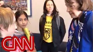 Watch Feinstein's tense exchange with children over climate