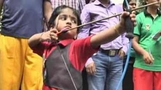 Toddler shines with bow and arrow