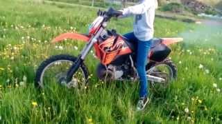 Girl rides KTM EXC 380