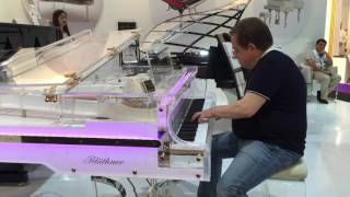 Russian pianist trying out our Bluthner Crystal Edition