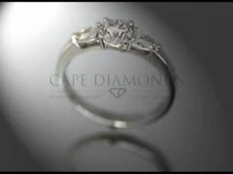 3 stone ring,1 round  diamond,2 pear shaped diamonds ,platinum,engagement ring