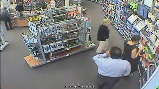 Woman caught on camera stuffing electronics under dress