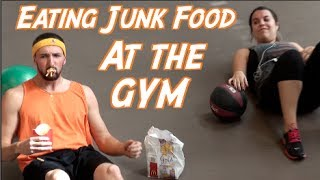 EATING JUNK FOOD AT THE GYM PRANK!!
