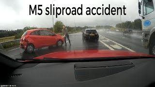 M5 slip road accident.  Car span 360 blocking both lanes in the wet