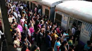 mumbai local train - women boarding the ladies only carriage width=