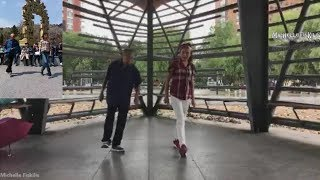 Chinese Granddaughter showing her Grandfather how to shuffle dance width=