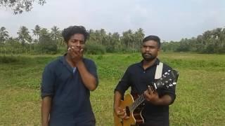 "Song 'Idhazhin Oram of innocence of love ""( Movie : Moonu)"