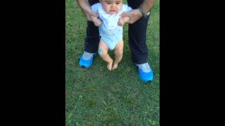 Baby walking on grass barefoot(George@5mos)