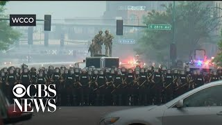 Police hold a line in Minneapolis amid protests